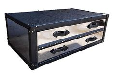 Wiley Coffee Table.  Made of chrome covered in synthetic crocodile leather, this table has mirrored drawer fronts and nail-head details for a major wow factor. The two drawers offer ample space for storage. Made in the USA.