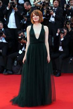 Emma Stone's emerald green Valentino Couture gown make her look like a modern-day goddess. With a pair of Jimmy Choo heels and some barely there gold rings from EF Collection and Graziela Gems, and this look is perfection.
