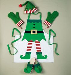 Gift idea to sew for the host or hostess who really gets into the Christmas spirit. McCall's M6860, Aprons, Oven Mitts, Hat, Slippers, and Table Leg Decorations