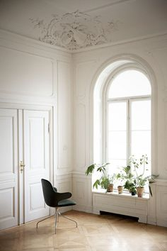 tall ceilings, white walls, simple, sparse, elegant