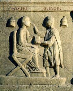 Relief depicting an oculist examining a patient (stone), Roman, (2nd century AD) / Museo della Civilta Romana, Rome, Italy / Giraudon / The Bridgeman Art Library