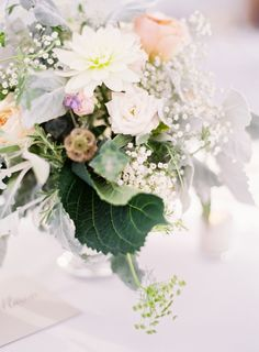 Photography : Christine Doneé   Floral Design : Florabundant   Reception Venue : Bartletts Farm Read More on SMP: http://www.stylemepretty.com/2016/02/19/classic-new-england-nantucket-greenhouse-wedding/
