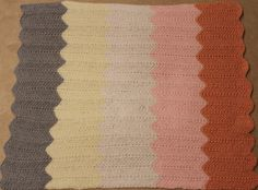 Pink chevron knit baby blanket. Original pattern from The Purl Bee.