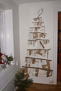 Sweet advent tree of brown paper wrapped gifts. Lots more close up pictures on blog