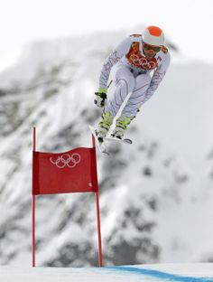Bode Miller surprisingly 8th in Olympic downhill - United States' Bode Miller jumps during the men's downhill at the Sochi 2014 Winter Olympics, Sunday, Feb. 9, 2014, in Krasnaya Polyana, Russia. (AP Photo/Charles Krupa)