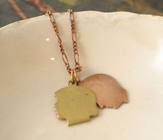 Child Silhouette Necklace...personalized with initials.