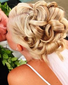 Bride's looped updo Wedding hairstyle ideas with under veil
