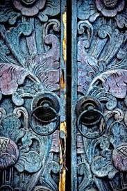 beyond the blue wood carved door...