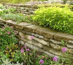We needed some new, low retaining walls in our top garden. And my idea? Reusing old, broken up concrete slabs to make the new 'bookleaf' walls.