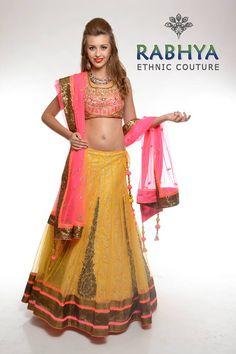 Style Code: RUJ 571- Yellow net lehenga with Chantilly lining and nicely embellished kalis with aari and highlighted with cut dana and Swarovski . The border of the sequin fabric and neon tapes. The set comes with neon blouse and dupatta.  Wanna make a purchase of this outfit, just log on to Rabhyaethnic.com or visit our store at: E-18, South Ex-II, New Delhi.
