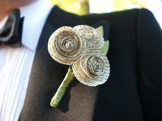 Paper flower boutonniere. Use paper from favorite love story, favorite quotes, poems, or love letters.