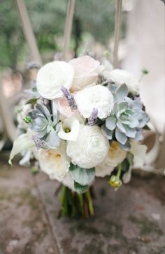 Modern style of round bridal bouquet using soft blues