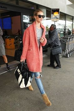Photo via: Popsugar It's no secret that model Rosie Huntington-Whiteley knows a thing or two when it comes to creating chic airport style. Here she is strutting her stuff in a statement bright pink co