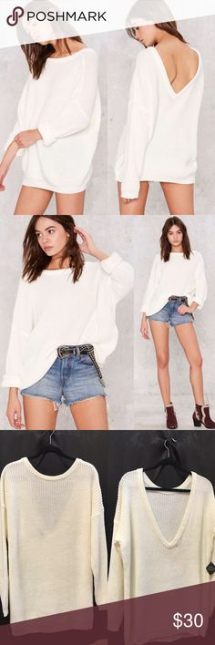 Nasty Gal Drop It Sweater. Brand new boutique item Don't be afraid to drop it low in this ivory sweater. It features a deep V at back, drop shoulder detailing, and ribbing at neck, hem, and cuffs. Oversized fit, unlined. By Nasty Gal. 🚩Brand new. Never worn boutique item.🚩 *Acrylic/Polyester/Nylon  *Runs true to size  *Machine wash cold  *Imported Nasty Gal Sweaters