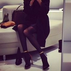 tights, sleek black dress, booties, black bag