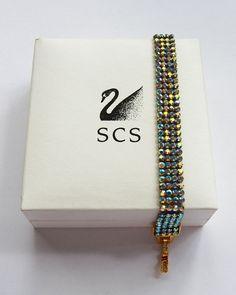 Swarovski 4 Row Tennis  bracelet Goldtone With Clear Crystals