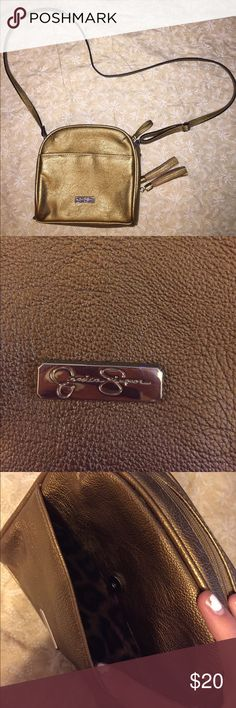 Jesica Simpson crossbody bag NEW and NEVER USED Jessica Simpson crossbody bag. A lot of pockets to organize all your stuff!! Color: shimmery gold. Great for a night out or a trip to the grocery story! Jessica Simpson Bags Crossbody Bags