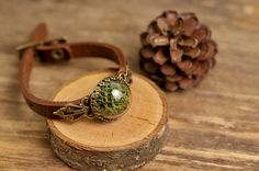 Genuine leather bracelet with moss.  Globe size is 20 mm / 0,79  I will ship your item within 3-5 business days after receipt of payment in a pretty box and a protective bubble mailer by priority air mail with tracking option.  In the case of purchasing several items at once, i will ship them all in one box. If you are buying our jewellery as a gift for someone, I can separate items into different bags with no additional charges, just please, inform me in the comment section during the c...