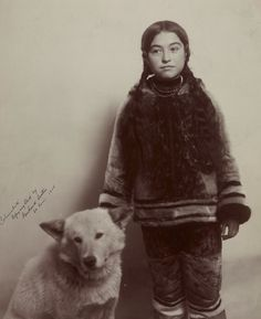 INUIT GIRL: Nancy Columbia and her dog. Picture taken at the World's Fair, (Louisiana Purchase Exposition) 1904 in St. Louis