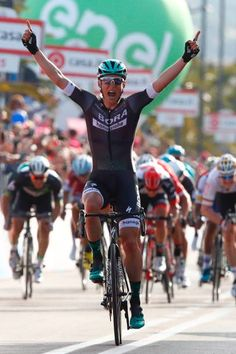 Austria's Lukas Postlberger of team Bora celebrates as he crosses the finish line to win the first stage of the 100th Giro d'Italia Tour of Italy...