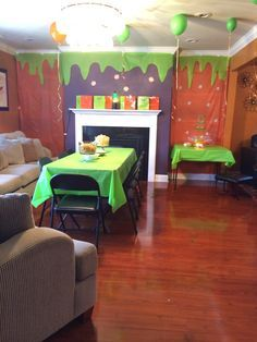 This was my set up for the KCA party...Covered my book shelves with cheap plastic table cover, cut out a slime design and stuck in on top. Blew up some balloons and got out my daughters lava lamp which I displayed next to the goody bags on my fireplace mantel. For a little extra effect I set up a drinking fountain with green Hawaiin Punch..... The kids loved it!