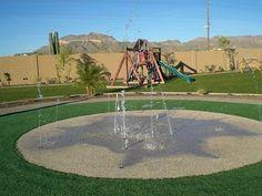 Splash pad + playground.