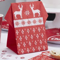 A cute and novel pack of Christmas paper napkins with a Nordic jumper design.These fun and quirky styled paper napkins are folded to show off a red Nordic print jumper with white patterns.  These would be great for the Christmas table to put a smile on your guests faces! 12 Napkins per pack, ideal for the perfect family Christmas. These napkins open up to be 40cm.Paper NapkinsWhen unfolded - 40cm.
