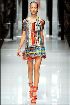 This fashion piece is designed by Versace, unknown year but looks quite recent.