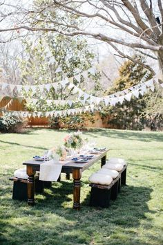 Garlands strung among the trees for bohemian style wedding ideas | fabmood.com