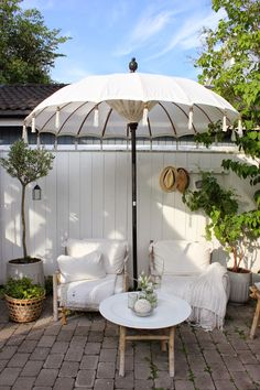 Outdoor Setting… White Balinese Umbrella + LOVE!!!!