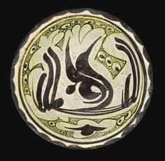 A NISHAPUR OR SAMARQAND POTTERY BOWL WITH A STYLISED INSCRIPTION IN THE SHAPE OF A BIRD, EASTERN PERSIA OR TRANSOXIANA, 10TH CENTURY