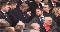 England Desperate To Attend World Cup Despite Russia Tensions   England football Manager Gareth Southgate (R) shakes hands with someone in the crowd next to former Liverpool Manager Kenny Dalglish (C) during the English Premier League football match between Manchester United and Liverpool at Old Trafford in Manchester north west England on March 10 2018.Oli SCARFF / AFP   England Manager Gareth Southgate has said his players are desperate to go to the World Cup in Russia despite soaring…