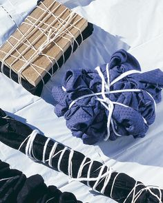 Wrapping with string protects parts of the fabric surface from contact with the bleach, creating a tie-dye effect.