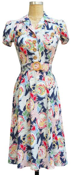 The Sweetie Dress is a classic early 1940's inspired dress with natural wood buttons by Trashy Diva. $121.