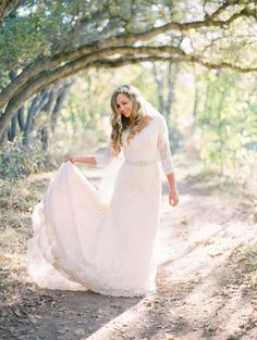 modest wedding dress with three quarter sleeves and a trumpet skirt from alta moda (modest bridal gown)