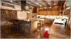 Modern rustic kitchen with concrete counter-tops, stained concrete floor, and a ceiling of rusting corrugated metal. Concrete Kitchen, Concrete Countertops, Concrete Floors, Kitchen Flooring, Home Design, Design Jobs, Design Ideas, Floor Design, Corrugated Tin Ceiling
