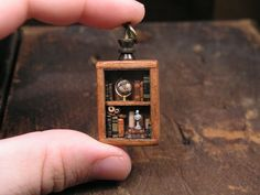 Miniature library pendant, full of tiny books, parchments, a globe and a bust Turning Stone, Microsoft, Steampunk, Book Necklace, Silver Pocket Watch, Miniature Crafts, Leather Books, Miniture Things, Glass Domes