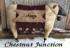 "Primitive sheep with a folky wool blanket on his back. He is adorned with a ""sheep"" stitchery and a rusty jingle bell around his neck. Measures 7"" when complete"