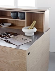 Form 45 // White pigmented oak with a steel tabletop a kitchen by Multiform