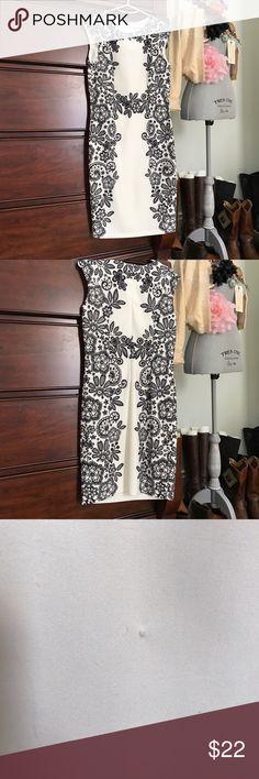 Liz Claiborne dress. Size 6 Liz Claiborne dress. Pretty black and white print. Comfy stretch fabric. Back zip. Small snag on bottom as shown in photo. NWOT. Liz Claiborne Dresses Midi