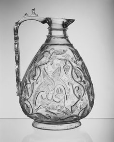 This rock crystal ewer is 1 of only 7 known in existence, now in collections across Europe. They were often in cathedral treasuries, rededicated after being captured from their original Islamic settings. Such high-quality rock crystal vessels were made for the rulers of Cairo during the Fatimid period (969-1171). This is confirmed by inscriptions which name specific rulers. Great skill was required to hollow out the raw rock crystal & carve the delicate, shallow decoration. #rock_crystal…