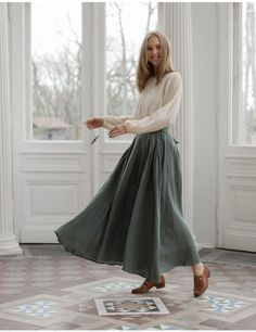 This garment was made in Paris in a family workshop, built in the arrondissement more than 30 years ago. We have been collaborating with this workshop since the beginning of our br Maxi Skirt Outfit Summer, Green Skirt Outfits, Long Skirt Outfits For Summer, Spring Outfits, Modest Wear, Modest Outfits, Maxis, Long Green Skirt, Romantic Outfit
