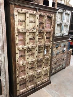 Beautiful, solid wood cabinet from India!  Each cabinet is unique & one of a kind!  The doors  have the original paint which has a great patina!  Come see our selection of solid wood furniture!  Manzel, 96 Foster St., Peabody, MA and www.manzelinc.com Reclaimed Doors, Rustic Wood Furniture, Solid Wood Cabinets, Online Furniture Stores, Carving, India, Paint, Boho, Unique
