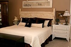 Old ceiling tins as headboard and door above bed