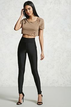 Forever 21  - A pair of nylon-stretch leggings featuring paneled seams at the knees and an elasticized waistband.