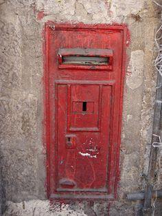 old mailbox built into wall in jerusalem's geula neighborhood