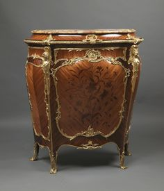 A Fine Louis XV Style Gilt-Bronze Mounted Marquetry Kingwood Side Cabinet by Joseph-Emmanuel Zwiener.   Joseph-Emmanuel Zwiener was an important Paris furniture maker of German extraction, who was born in Silesia circa 1848. He produced the very finest furniture, often copied from public collections in France.  He employed as his sculptor, Leon Messagé, the Parisian sculptor of genius.