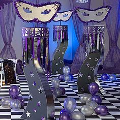 These Masquerade Columns feature a black curved base with star accents and silver and purple top. Each Masquerade Column measures 7 feet high!