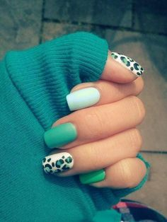 Shades of green and leopard nail art.