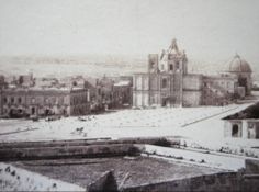 Floriana Malta showing the pre 1868 St. Publius church and granaries with the Sarria church in background